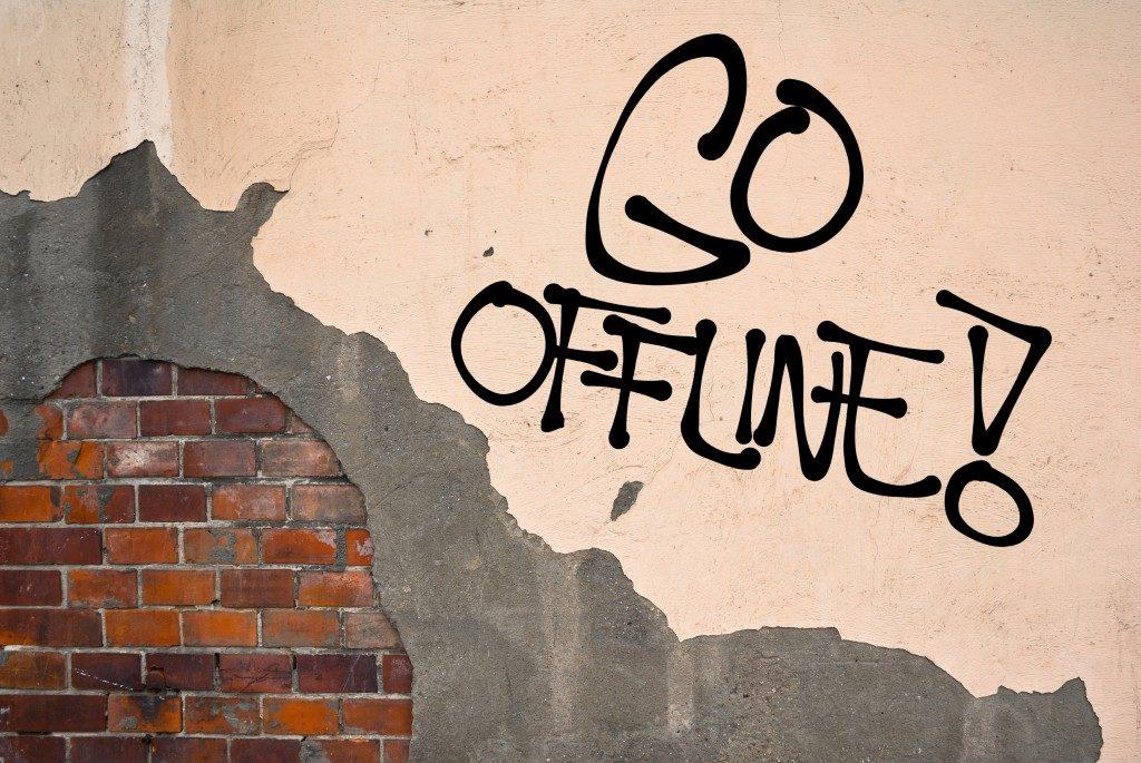 Go Offline - handwritten graffiti sprayed on the wall