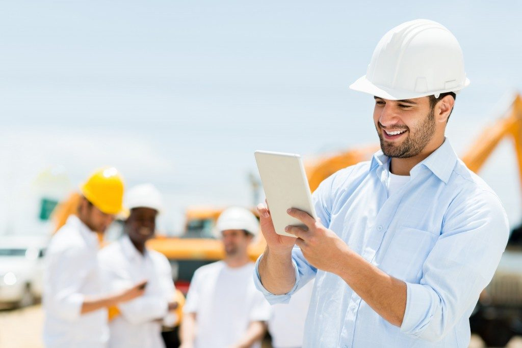 construction workers using GPS system to track the site