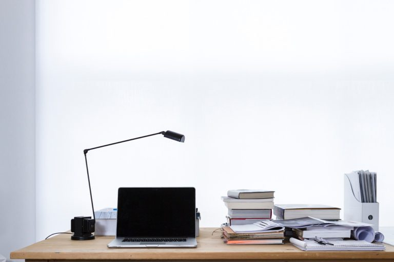 office desk with a laptop