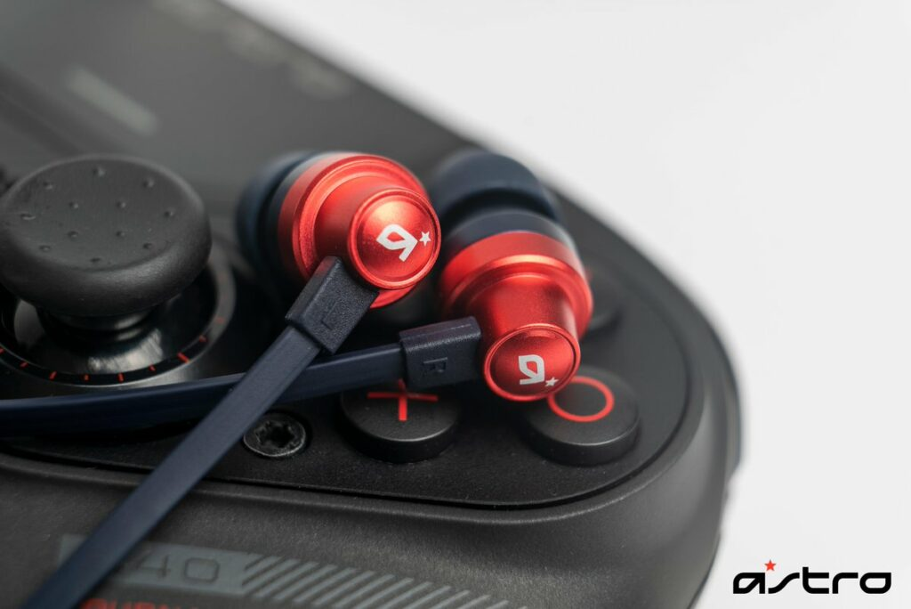 red earphones on a controller
